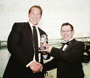 Bob Casey of London Irish receives his Irish World Award for Services to Rugby from Irish World Sports Editor Damian Dolan