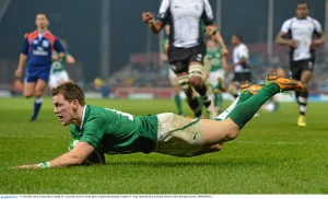 Ulster winger Craig Gilroy dives over for the second of his three tries in the win over Fiji