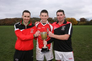 Eddie McGuigan, Joe Cashman and manager DJ Bradley get their hands on another cup