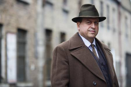 Stanley in character as Inspector Hackett in the BBC drama series, Quirke