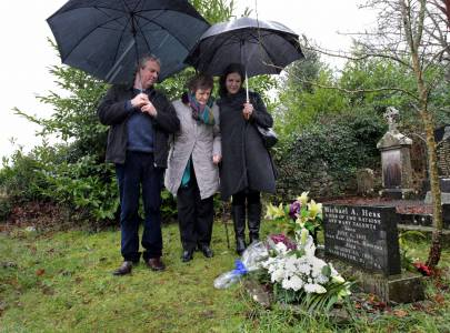 Philomena Lee pictured at her  son Michael A Hess' grave with her son and daughter