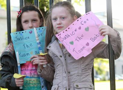 Amy Rose Hyland Holden and her cousin Abbie Conran pictured at a vigil to demand justice for the mothers and children who endured cruelty at the hands of the Irish State