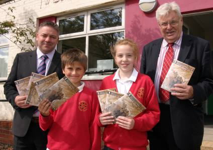 Year 6 pupils Marek Menke and Natalie Watson receive their brochures from head teacher Stephen Fallon and Tyneside Irish Centre secretary Tony Corcoran