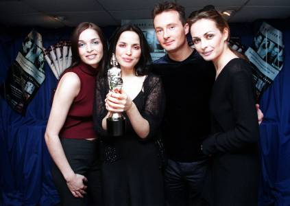 Sharon (right) with The Corrs celebrating their Brit Awards win in 1999