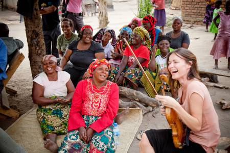 Sharon plays some Irish music in the Kimamba Village, Tanzania. Picture: Barry McCall/Oxfam
