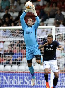 "At 6'2"", David Forde can get high to clear the danger. Picture: Brian Tonks/ Millwall FC"