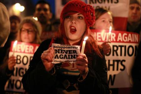 Demonstrators hold placards and candles in memory of Savita Halappanavar during a march to Irish Parliament in Dublin on Nov 17, 2012.