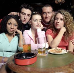 Natalie with the cast of Two Pints of Lager and a Packet of Crisps