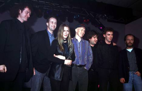 Altan accept a Hot Press award in 1994. Frankie Kennedy is to Mairead's right