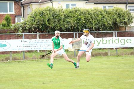 Mark O'Dwyer evades Kildare full back Mark Grace