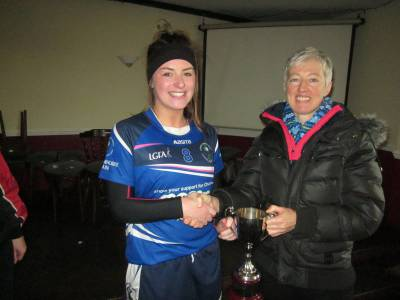 1-St Mary's captain Laura Gillespie accepts the Ann Dunning Memorial Cup from Ann's friend Bridget Browne