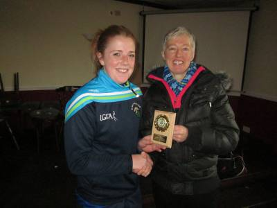 1-Cathy Carey, St Mary's, receives Player of the Tournament from Bridget Brown