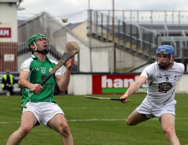 Mark O'Dwyer keeps his eye on the ball. Also pictured is Kildare's Dinny Stapleton. Picture: Sean Brilly