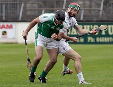 London's Peter Phelan keeps his balance despite the shoulder charge of Kildare's Johnny Byrne