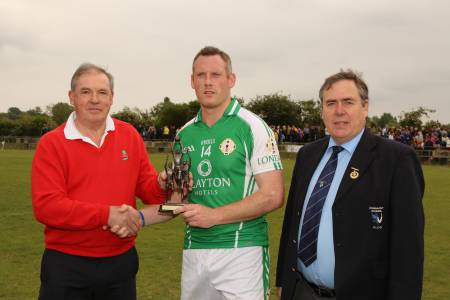 Lorcan Mulvey collects his man of the match award following the London v Roscommon match. Photo: Brendan Vaughan