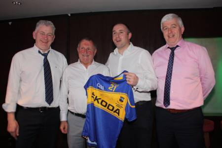Another item of Tipperary GAA Heritage finds a new home: Drangan man Johnny Whyte is pictured with Eoin Kelly and Tipperary GAA Officers - Secretary Tim Floyd (extreme left) and Chairman Michael Bourke (extreme right) at last Friday's successful Tipperary GAA fundraiser in the Intercontinental Hotel in London.