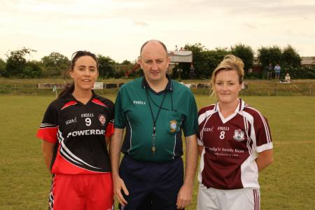 Captains Orla McWeeney and Catherine Barrett with referee John Doyle