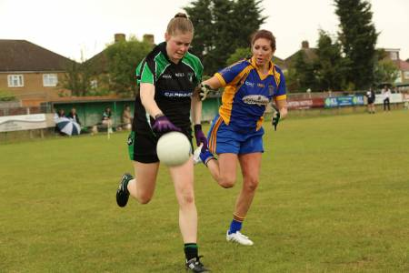 Roisin McDonald of Fulham Irish gets away from Parnells' Pamela Sherwood