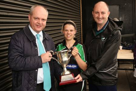 Finbar Holian of The Claddagh Ring presents the cup to winning captain Anne Marie McDonald. Also pictured is London Ladies Chairman John Doyle