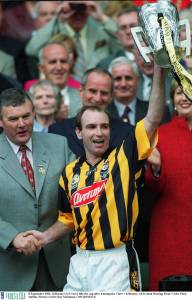 DJ  Carey lifting the Liam McCarthy Cup after winning the 2002 All Ireland  Final against Clare