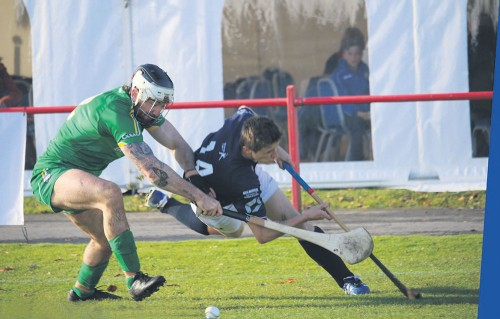 Celtic Cousins collide in Shinty-Hurling Internationals - Ireland's Michael Burke and Scotland's Fraser Heath battle during Saturday's Senior Shinty-Hurling International in Inverness. Photo by Cóilín Duffy