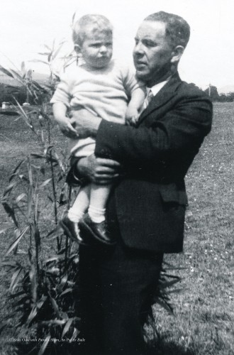 Seán in his father's arms, aged eighteen months, June 1937, in front of the family home near Ballylickey, west Cork. taken from  An Poc Ar Buile – The Life & Times of Seán Ó Sé by Seán Ó Sé with Patricia Ahern, published by The Collins Press, 2015