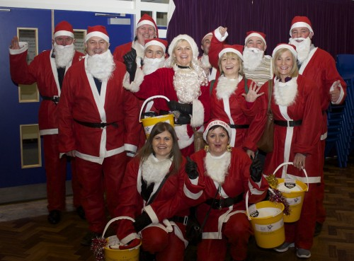 Angela and the team of Santa Dashers in 2014 - Santa's set to dash around Pinner for St Luke's