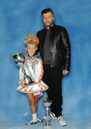 Rose McDowell the U8 champion with her teacher Mark Marshall.